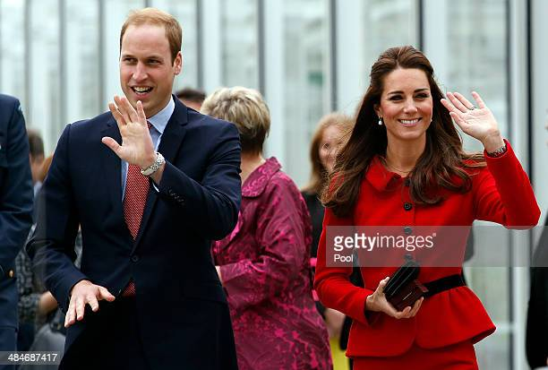 Prince William Duke of Cambridge and Catherine Duchess of Cambridge wave as they leave the ceremony to open the new visitors centre at the...