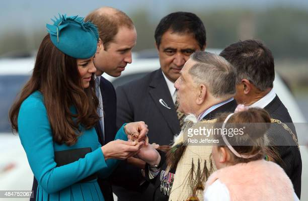 Prince William Duke of Cambridge and Catherine Duchess of Cambridge receives a traditional Maori Greenstone gift at the official greeting at Dunedin...