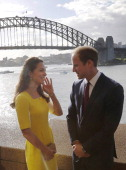 Prince William Duke of Cambridge and Catherine Duchess of Cambridge pose in front of the Sydney Harbour Bridge at a reception at the Sydney Opera...