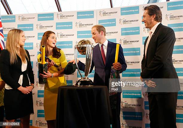 Prince William Duke of Cambridge and Catherine Duchess of Cambridge hold cricket bats presented to them in front of the Cricket World Cup by...
