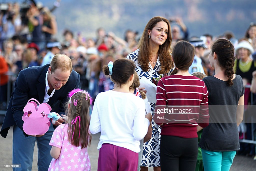 Prince William, Duke of Cambridge and Catherine, Duchess of Cambridge speak with a group of young children during a visit to Echo Point on April 17, 2014 in Katoomba, Australia. The Duke and Duchess of Cambridge are on a three-week tour of Australia and New Zealand, the first official trip overseas with their son, Prince George of Cambridge.