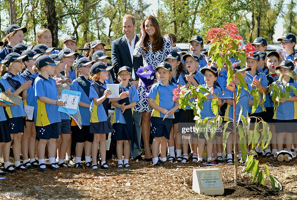 <a gi-track='captionPersonalityLinkClicked' href=/galleries/search?phrase=Prince+William&family=editorial&specificpeople=178205 ng-click='$event.stopPropagation()'>Prince William</a>, Duke of Cambridge and <a gi-track='captionPersonalityLinkClicked' href=/galleries/search?phrase=Catherine+-+Duchess+of+Cambridge&family=editorial&specificpeople=542588 ng-click='$event.stopPropagation()'>Catherine</a>, Duchess of Cambridge pose with Winmalee Girl Guides after planting a Summer Red Eucalyptus tree at Winmalee Guide Hall in Yellow Rock during the eleventh day of their official tour to New Zealand and Australia on April 17, 2014 in Winmalee, Australia. The Duke and Duchess of Cambridge are on a three-week tour of Australia and New Zealand, the first official trip overseas with their son, Prince George of Cambridge.