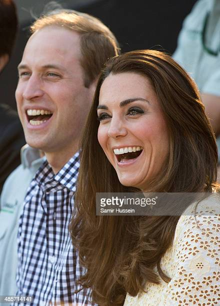 Prince William Duke of Cambridge and Catherine Duchess of Cambridge smile as they watch a bird display Taronga Zoo on April 20 2014 in Sydney...