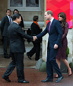 Prince William Duke of Cambridge and Catherine Duchess of Cambridge greet Chinese President Xi Jinping at a creative industry event to celebrate...