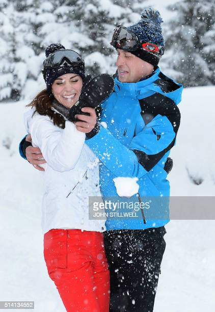 Prince William Duke of Cambridge and Catherine Duchess of Cambridge laugh after the Duchess threw a snowball at Prince William during a private break...