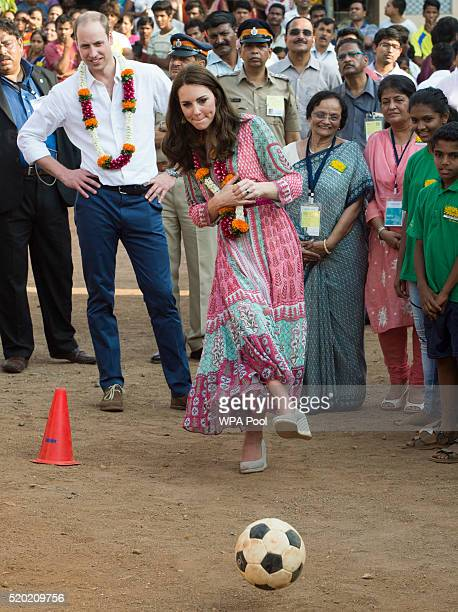 Prince William Duke of Cambridge and Catherine Duchess of Cambridge play football games during a visit to the Banganga Water tank where they met...