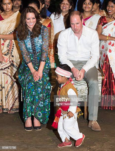 Prince William Duke of Cambridge and Catherine Duchess of Cambridge watch a boy dance during a Bihu Festival Celebration at Diphlu River Lodge...