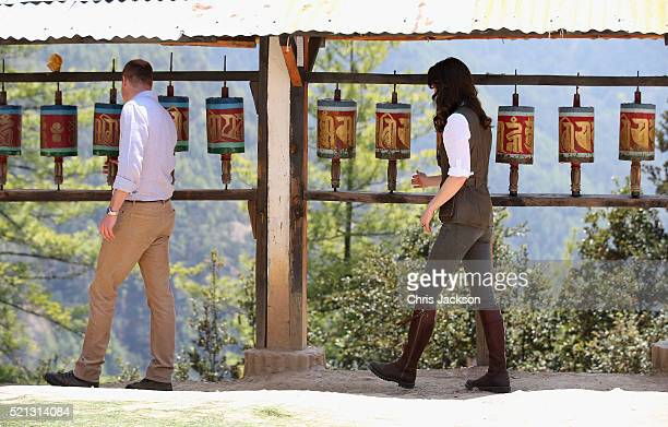 Prince William Duke of Cambridge and Catherine Duchess of Cambridge spin prayer wheels on the trek up to Tiger's Nest during a visit to Bhutan on the...
