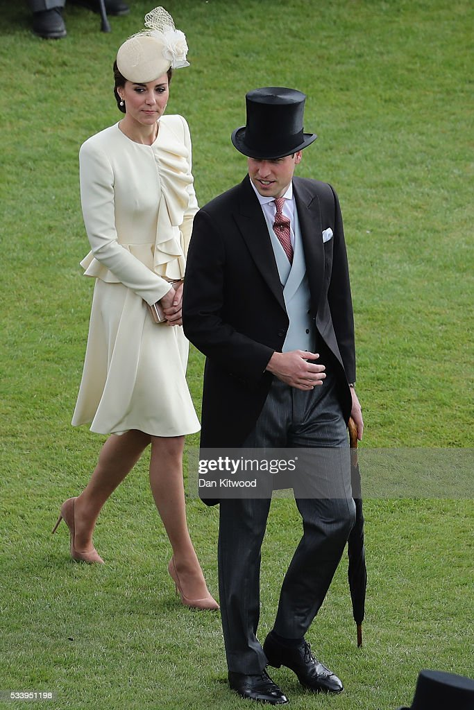 Prince William, Duke of Cambridge and Catherine, Duchess of Cambridge arrive to greet guests attending a garden party at Buckingham Palace on May 24, 2016 in London, England.