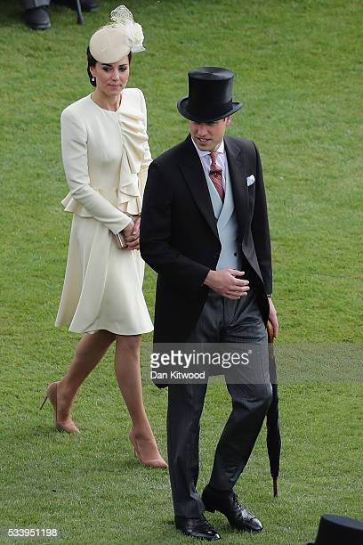 Prince William Duke of Cambridge and Catherine Duchess of Cambridge arrive to greet guests attending a garden party at Buckingham Palace on May 24...