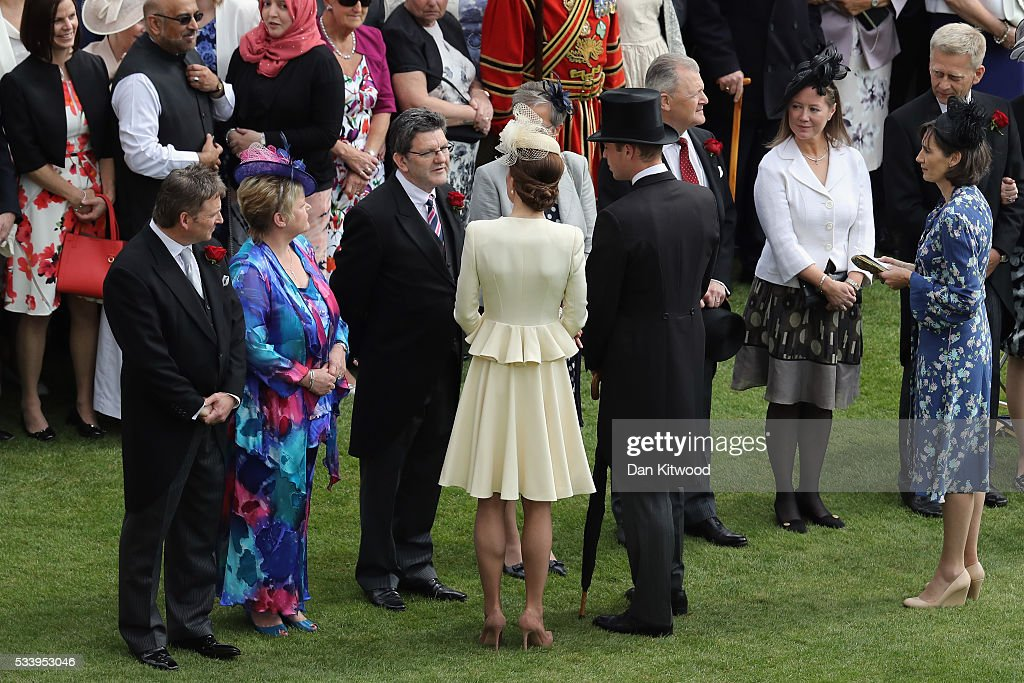 Prince William, Duke of Cambridge and Catherine, Duchess of Cambridge greet guests attending a garden party at Buckingham Palace on May 24, 2016 in London, England.