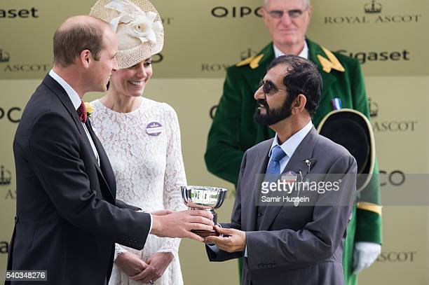 Prince William Duke of Cambridge and Catherine Duchess of Cambridge award the Duke of Cambridge Stakes winners trophy to owner Mohammed bin Rashid Al...