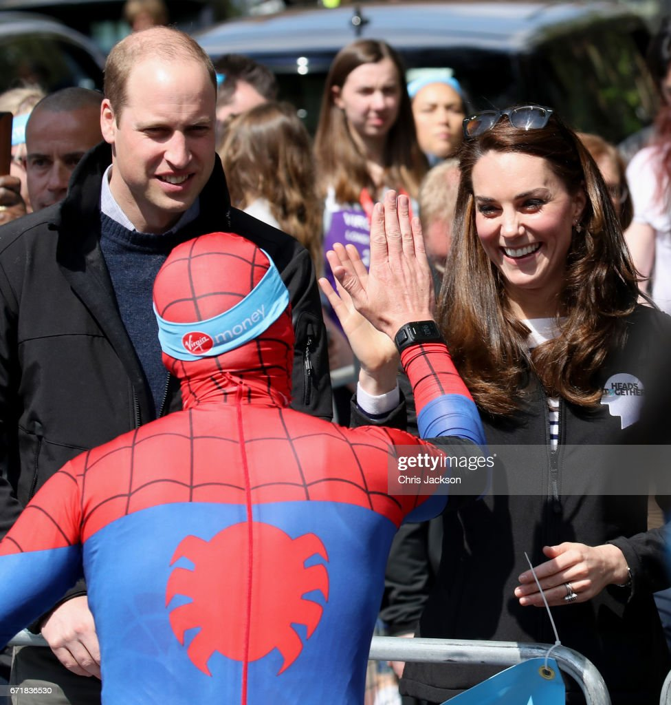 Prince William, Duke of Cambridge and Catherine, Duchess of Cambridge cheer on and hand out water to runners during the 2017 Virgin Money London Marathon on April 23, 2017 in London, England. The Duke and Duchess of Cambridge and Prince Harry, are spearheading Heads Together, in partnership with eight leading mental health charities, that are tackling stigma, raising awareness, and providing vital help for people with mental health problems.