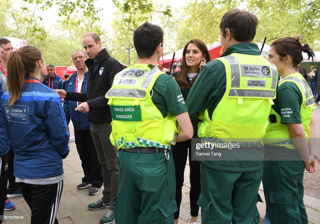 Prince William, Duke of Cambridge and Catherine, Duchess of Cambridge meet volunteers during the 2017 Virgin Money London Marathon on April 23, 2017 in London, England.