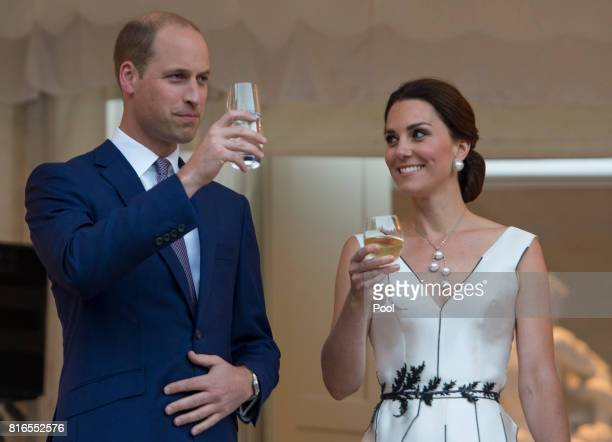 Prince William Duke of Cambridge and Catherine Duchess of Cambridge toast HM The Queen at the Queen's Birthday Garden Party at the Orangery Lazienki...