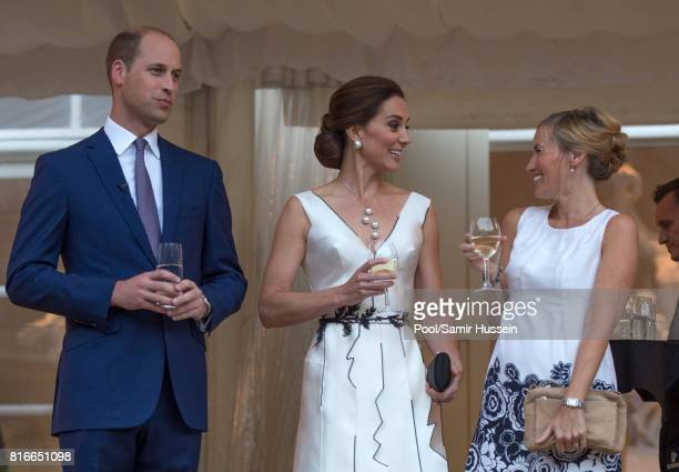 Prince William Duke of Cambridge and Catherine Duchess of Cambridge attend the Queen's Birthday Garden Party at the Orangeryeduring an official visit...