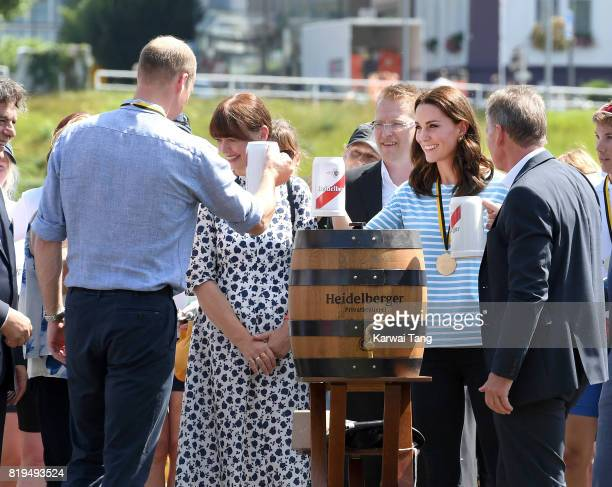 Prince William Duke of Cambridge and Catherine Duchess of Cambridge celebrate with a beer after participating in a rowing race between the twinned...