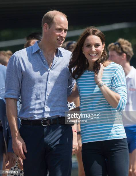 Prince William Duke of Cambridge and Catherine Duchess of Cambridge walk together after participating in a rowing race between the twinned town of...
