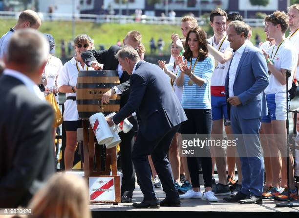 Prince William Duke of Cambridge and Catherine Duchess of Cambridge after participatin opening a beer barral after a rowing race between the twinned...