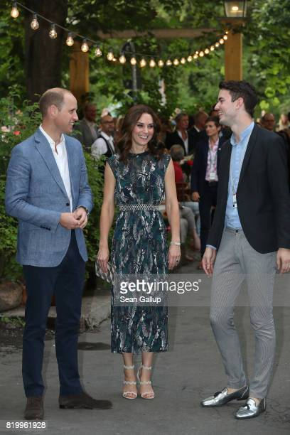 Prince William Duke of Cambridge and Catherine Duchess of Cambridge chat with Nils Juergens of Claerchen's as they arrive at a reception at...