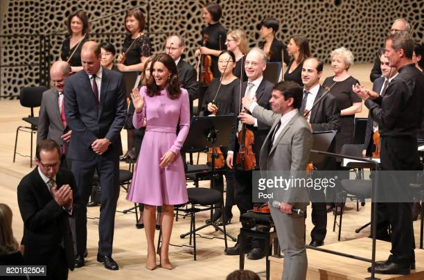 Prince William Duke of Cambridge and Catherine Duchess of Cambridge are welcomed before they receive a quick lesson to conduct an orchestra at...