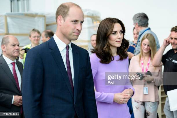 Prince William Duke of Cambridge and Catherine Duchess of Cambridge take a tour of Airbus before taking their children to see helicopter models H145...