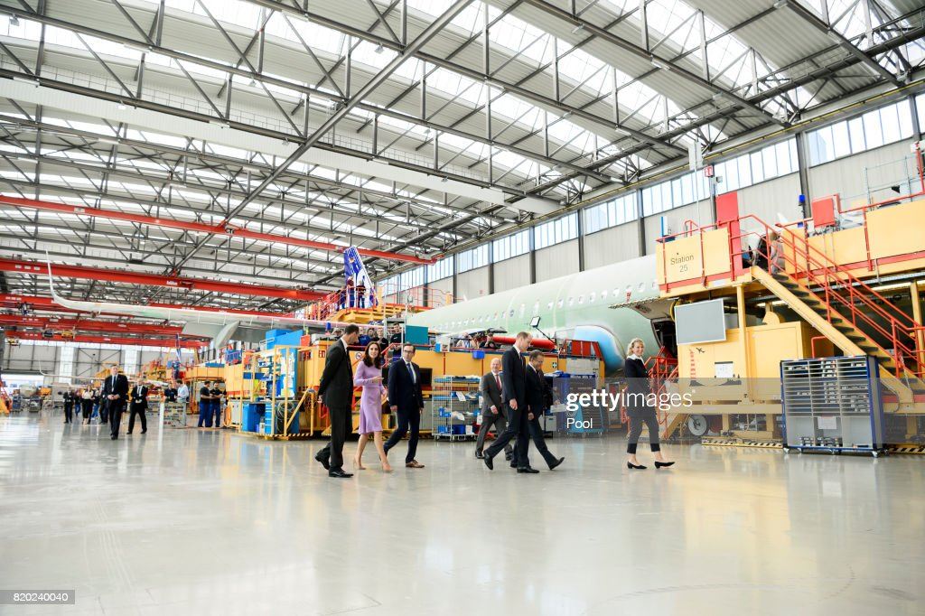 Prince William, Duke of Cambridge and Catherine, Duchess of Cambridge take a tour of Airbus before taking their children to see helicopter models H145 and H135 ahead of departing from Hamburg airport on the last day of their official visit to Poland and Germany on July 21, 2017 in Hamburg, Germany.