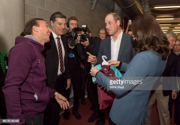 Prince William Duke of Cambridge and Catherine Duchess of Cambridge chat with West Ham player Mark Noble and West Ham manager Slaven Bilic during the...