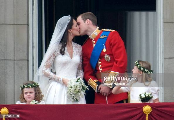TRH Prince William Duke of Cambridge and Catherine Middleton Duchess of Cambridge kiss on the balcony of Buckingham Palace following their wedding on...