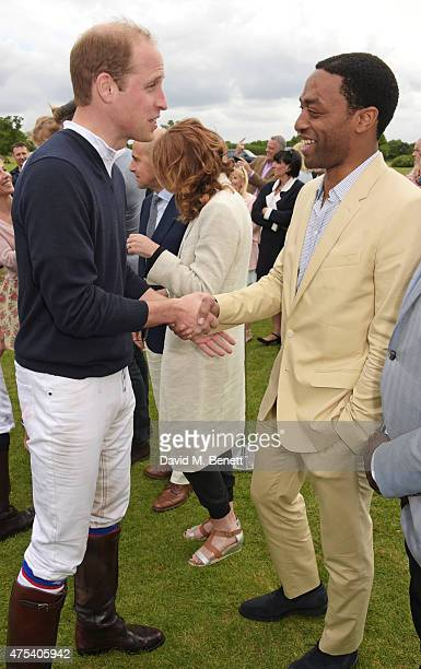 Prince William Duke of Cambridge and Chiwetel Ejiofor attend day two of the Audi Polo Challenge at Coworth Park on May 31 2015 in London England