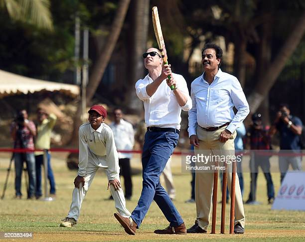 Prince William Duke of Cambridge and former Indian cricketer Dilip Vengsarkar enjoy a game of cricket at the Oval Maidan during a visit to meet...