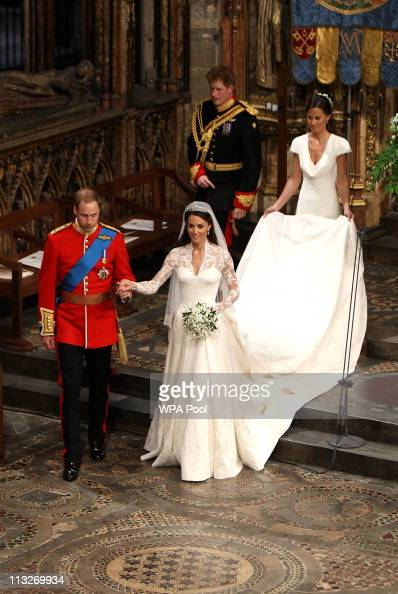 Prince William Duke of Cambridge and his new bride Catherine Duchess of Cambridge walk down the aisle followed by best man Prince Harry and Maid of...