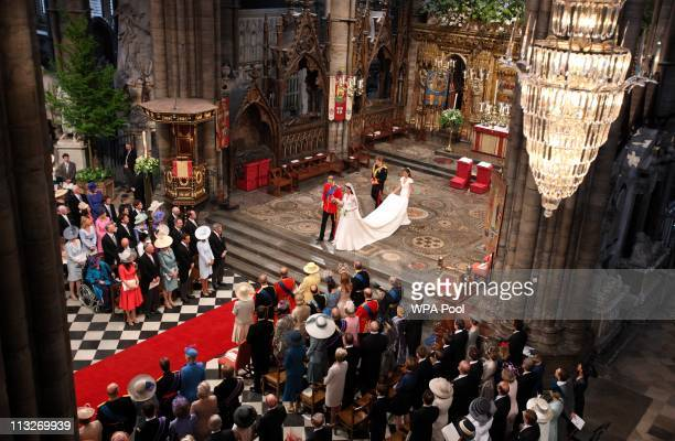 Prince William Duke of Cambridge and his new bride Catherine Duchess of Cambridge walk down the aisle followed by Maid of Honour Pippa Middleton and...