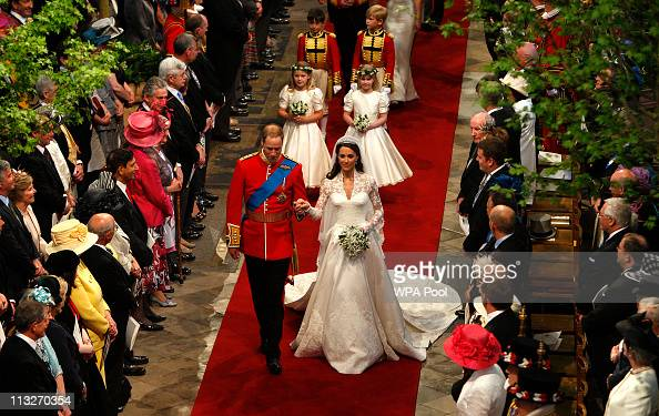 Prince William Duke of Cambridge and his new bride Catherine Duchess of Cambridge walk down the aisle at the close of their wedding ceremony at...