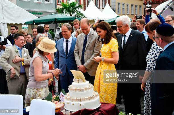 Prince William Duke of Cambridge and his wife Kate Duchess of Cambridge are shown a huge cake under the eyes of Heidelberg Mayor Eckart Wuerzner and...