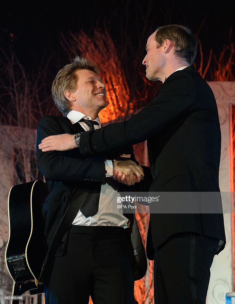 Prince William, Duke of Cambridge (R) and Jon Bon Jovi onstage after performing together at the Centrepoint Gala Dinner at Kensington Palace on November 26, 2013 in London, England.