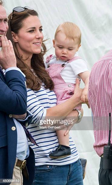 Prince William Duke of Cambridge and Prince George attend the Jerudong Park Trophy at Cirencester Park Polo Club on June 15 2014 in Cirencester...