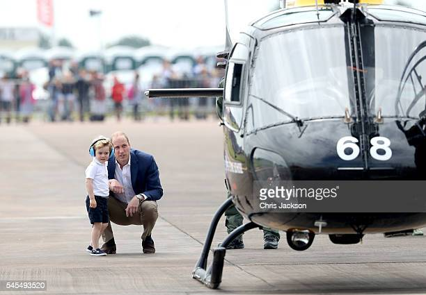 Prince William Duke of Cambridge and Prince George during a visit to the Royal International Air Tattoo at RAF Fairford on July 8 2016 in Fairford...