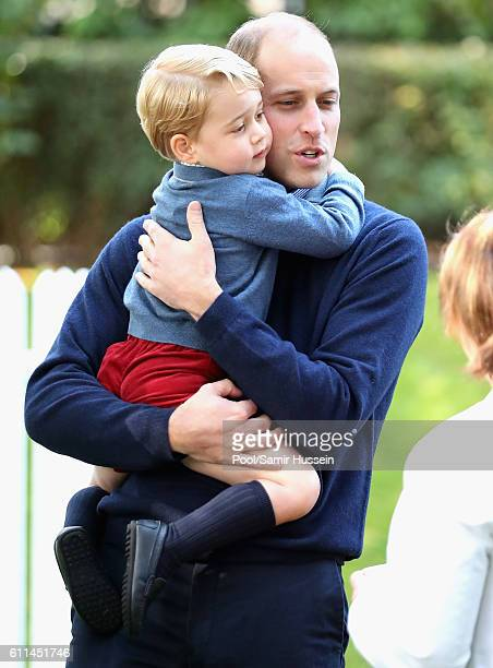 Prince William Duke of Cambridge and Prince George of Cambridge attend a children's party for Military families during the Royal Tour of Canada on...