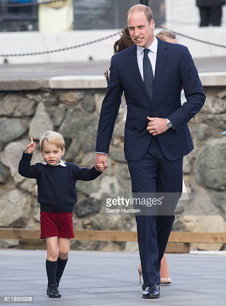 Prince William Duke of Cambridge and Prince George of Cambridge arrive to depart Victoria by sea plane on October 1 2016 in Victoria Canada