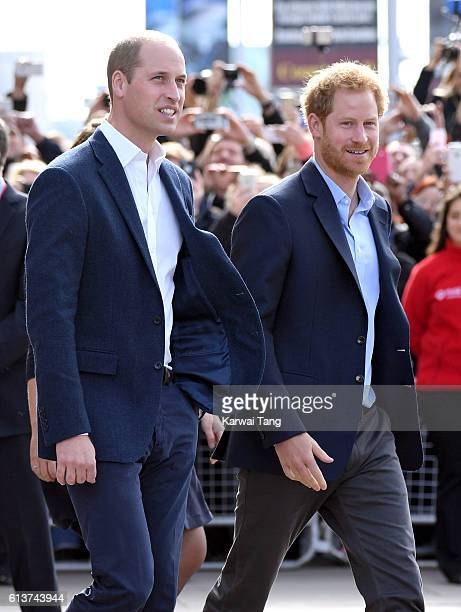 Prince William Duke of Cambridge and Prince Harry arrive to celebrate World Mental Health Day with Heads Together at the London Eye on October 10...