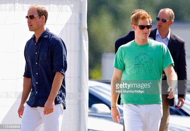 Prince William Duke of Cambridge and Prince Harry arrive to play in the Audi Polo Challenge at Coworth Park Polo Club on August 3 2013 in Ascot...