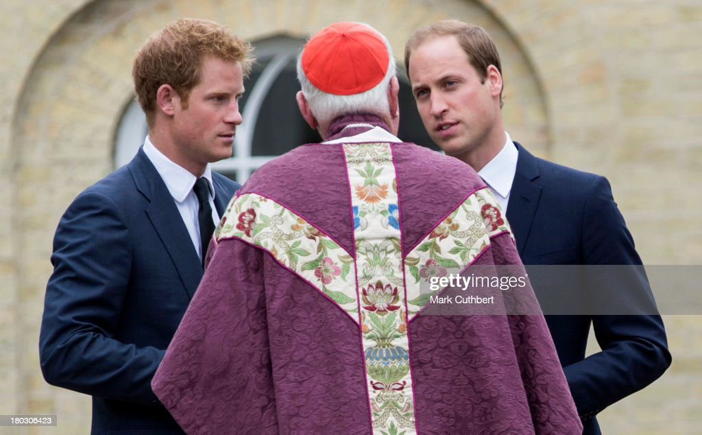 Prince William, Duke of Cambridge and Prince Harry attend a requiem mass for Hugh van Cutsem who passed away on September 2nd 2013 at Brentwood Cathedral on September 11, 2013 in Brentwood, England.