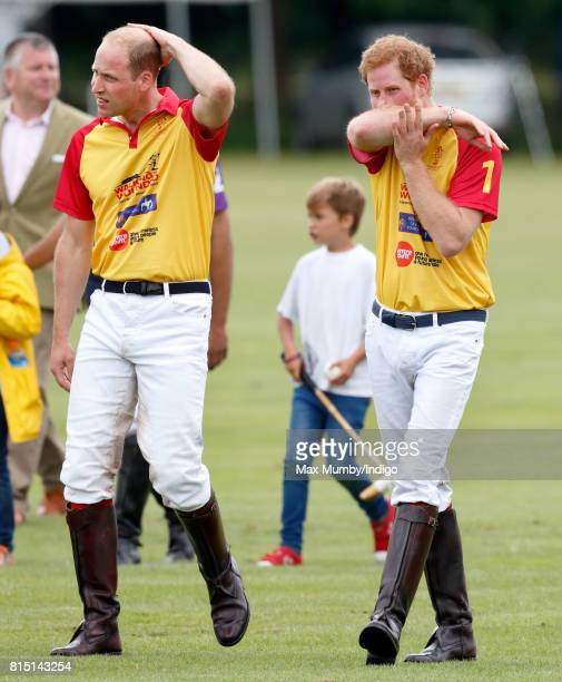 Prince William Duke of Cambridge and Prince Harry attend the presentation after playing in the Jerudong Park Trophy charity polo match at Cirencester...