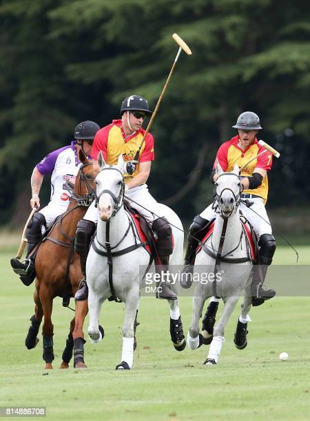 Prince William Duke of Cambridge and Prince Harry compete for the ball during The Jerudong Park Trophy at Cirencester Park Polo Club on July 15 2017...