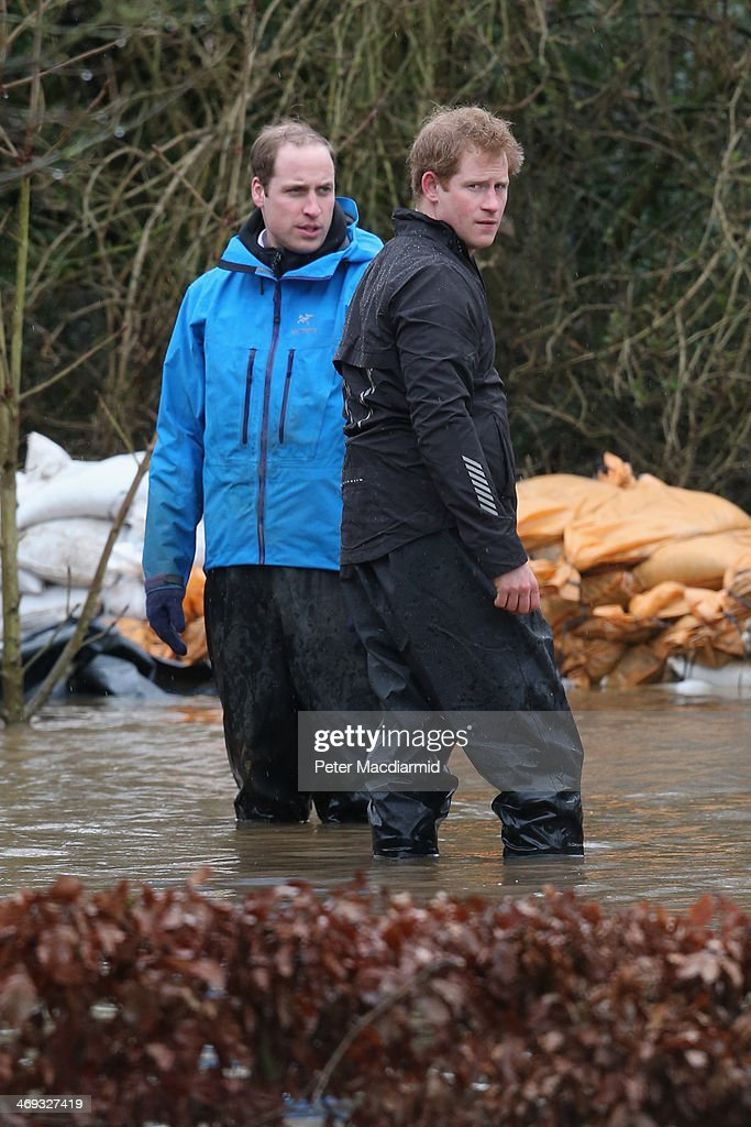 <a gi-track='captionPersonalityLinkClicked' href=/galleries/search?phrase=Prince+William&family=editorial&specificpeople=178205 ng-click='$event.stopPropagation()'>Prince William</a>, Duke of Cambridge and <a gi-track='captionPersonalityLinkClicked' href=/galleries/search?phrase=Prince+Harry&family=editorial&specificpeople=178173 ng-click='$event.stopPropagation()'>Prince Harry</a> help with flood defences around a school on February 14, 2014 in Datchet, United Kingdom. Flood water has remained high in some areas and high winds are causing disruption to other parts of the UK with the Met Office issuing a red weather warning.