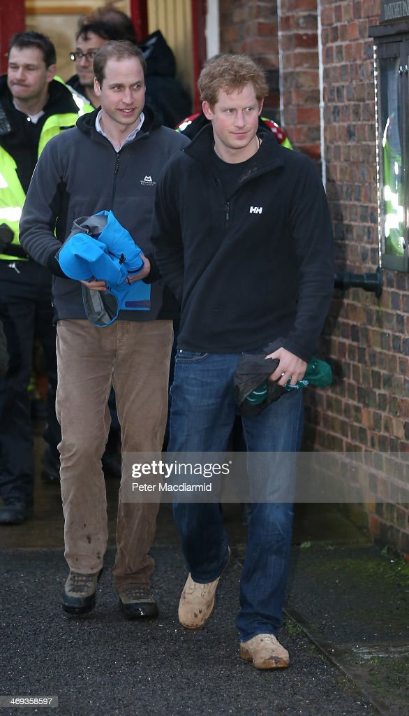 Prince William, Duke of Cambridge and <a gi-track='captionPersonalityLinkClicked' href=/galleries/search?phrase=Prince+Harry&family=editorial&specificpeople=178173 ng-click='$event.stopPropagation()'>Prince Harry</a> leave Datchet after helping with flood defences on February 14, 2014 in England. Flood water has remained high in some areas and high winds are causing disruption to other parts of the UK with the Met Office issuing a red weather warning.