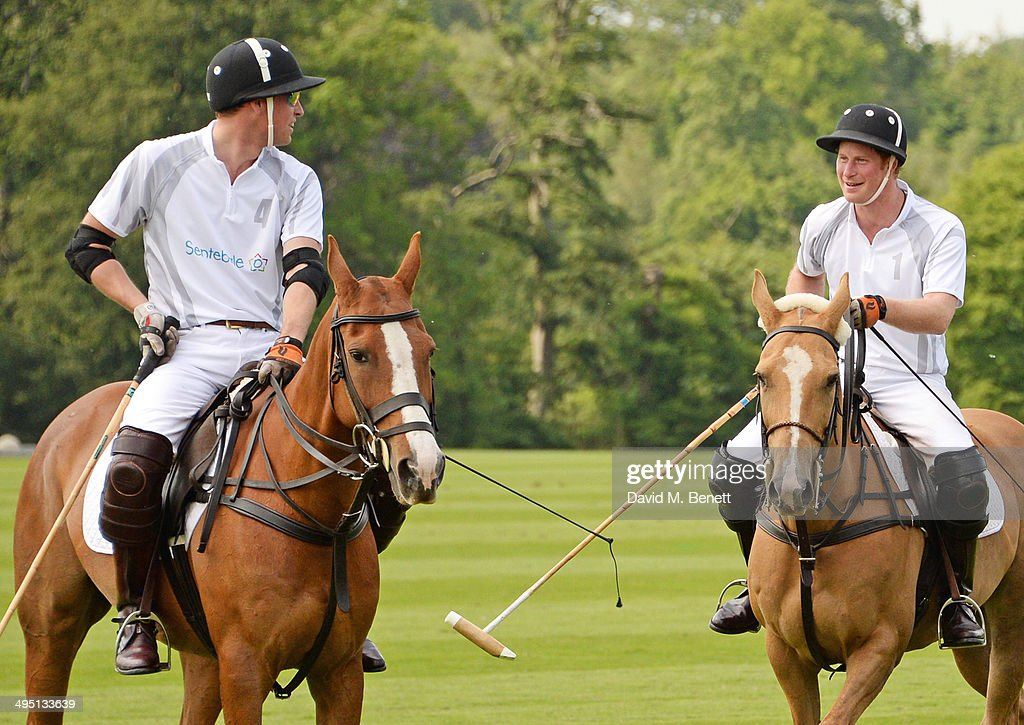 Prince William (L), Duke of Cambridge, and Prince Harry play during day two of the Audi Polo Challenge at Coworth Park Polo Club on June 1, 2014 in Ascot, England.