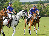 Prince William Duke of Cambridge and Prince Harry play during the Kent and Curwen Royal Charity Polo Cup at Watership Down Sydmonton Court Estate on...