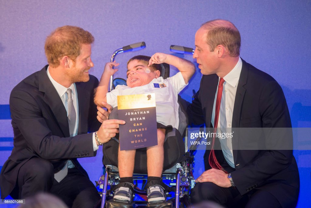 Prince William, Duke of Cambridge and Prince Harry present an award to 11 yr old Jonathan Ryan at the Diana Award's at St James' Palace on May 18, 2017 in London, England.